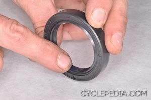 3. Lubricate oil seal lips with grease.