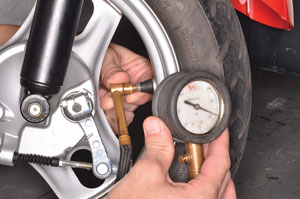 7. Set the tire pressure to  specification.