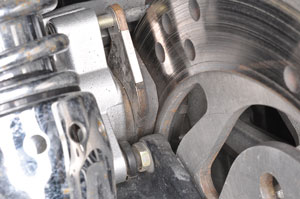 6. Inspect the brake pads, discs and fluid.