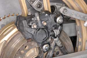 2. Smack the bake caliper with a rubber mallet to free a seized disc brake.
